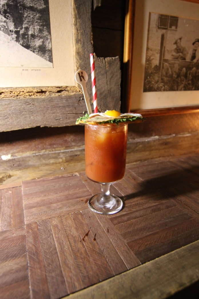 Shady's present a brunch drink with a breakfast garnish